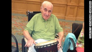 Dr. Sanford A. Shmerling, who has Alzheimer\'s, joined in drum circle activity recently at his nursing home in Atlanta.
