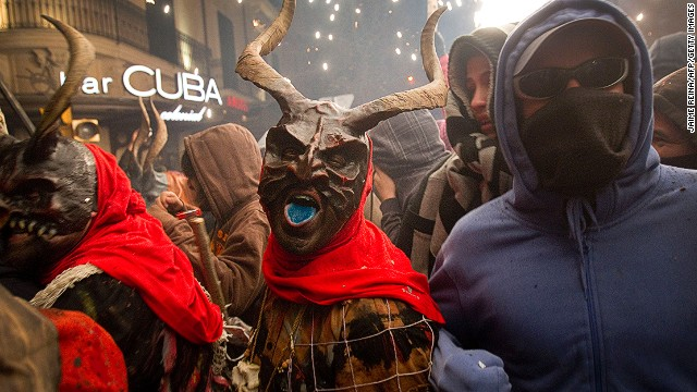 A reveler wearing a demon costume takes part in the traditional festival of Correfoc in Palma de Mallorca. Participants dress as demons and devils and move through the streets scaring people with fire and fireworks.