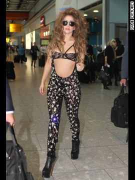 Lady Gaga rocks an eye-catching outfit as she lands in London on August 27.