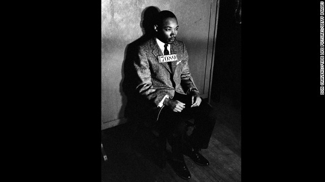 King sits for a police mugshot after his arrest for directing a citywide boycott of segregated buses on February 24, 1956.