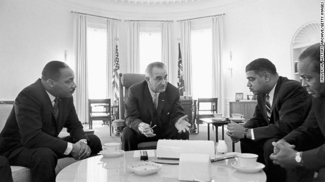 President Lyndon B. Johnson talks with King and civil rights leaders at the White House. On July 2, 1964, Johnson signed the Civil Rights Act into law.