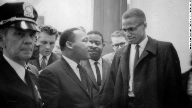King speaks with Malcolm X at a press conference on March 26, 1964.