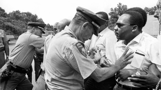 Mississippi patrolmen shove King during the 220-mile March Against Fear from Memphis, Tennessee, to Jackson, Mississippi, on June 8, 1966.