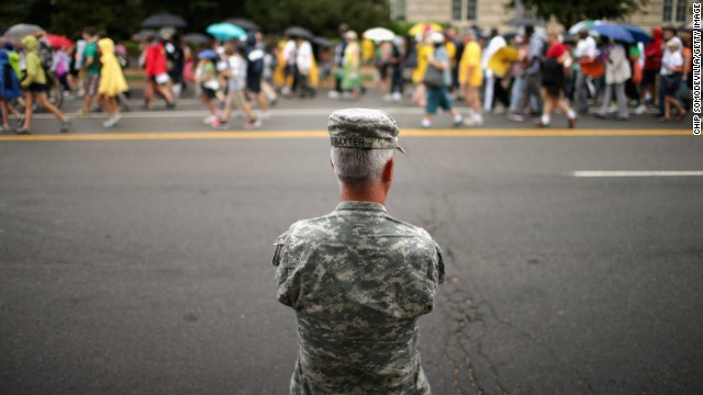A member of the U.S. Army National Guard watches as thousands of people march from Capitol Hill to the Lincoln Memorial in Washington on August 28.