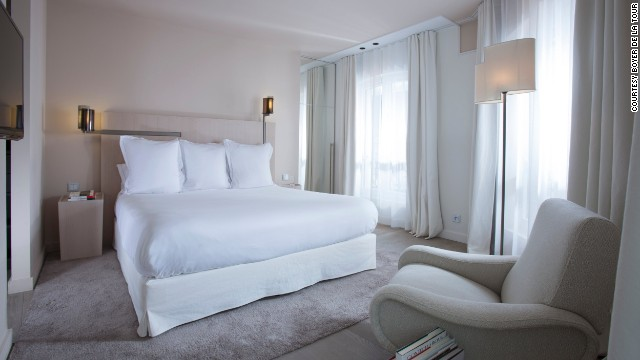 Hotel de Nell features triple-glazed windows, weighty 175-pound doors, wood floors topped with thick carpets, dense velvet blinds and wood ceilings with micro holes that absorb noise.