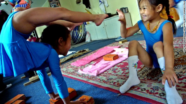 """In order to learn how to balance your body on your hands and on other people, you need to gain upper body strength. My homework used to be 300 push ups a day,"" said former contortionist Baasankhuu."