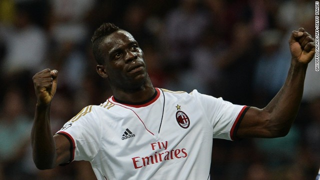 Mario Balotelli celebrates scoring Milan's second goal against PSV in the Champions League.