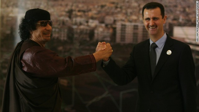 Moammar Gadhafi and al-Assad clasp hands at the opening session of the Arab Summit in Damascus on March 29, 2008.