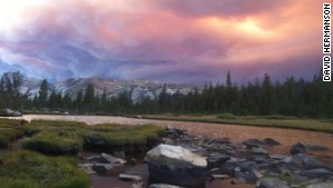 Smoke from the Rim Fire darkens the sky at Dorothy Lake in Yosemite.\n