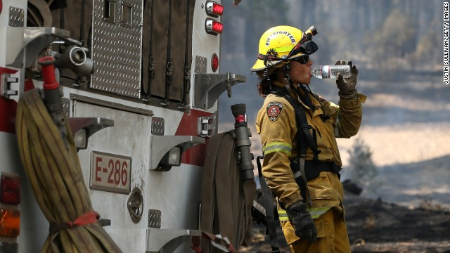 A firefighter takes a break from battling the Rim Fire near Groveland, California, on August 28.