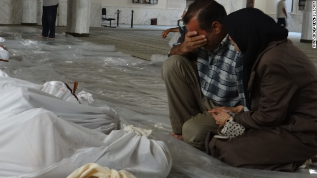 A man mourns over the bodies of those killed in a suspected chemical weapon attack in a suburb of Damascus, Syria, on Wednesday, August 21. Syrian rebels said that poisonous gas rained down from rockets overnight, but authorities have denied the allegations that they used chemical weapons and accused the opposition of staging the attacks. U.S. officials, however, said there were