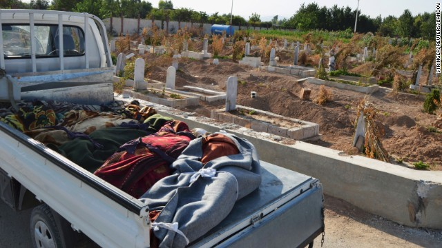 Victims of the attack are laid in the back of a truck in the Hamoria area of Damascus on August 21.