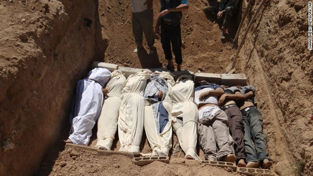 Victims are buried in a suburb of Damascus on August 21.