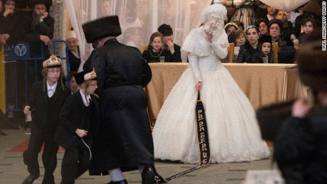 In Jerusalem, bride Hannah Batya Penet dances with her relative during her wedding to Rabbi Shalom Rokach, the Grandson of the Belz Rabbi.