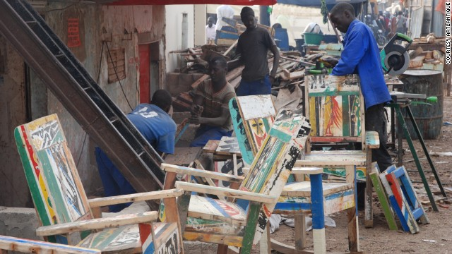 The company's workshop in Dakar, Senegal's capital, has 12 young craftsmen who undertake the arduous task of re-modeling the samba wood.