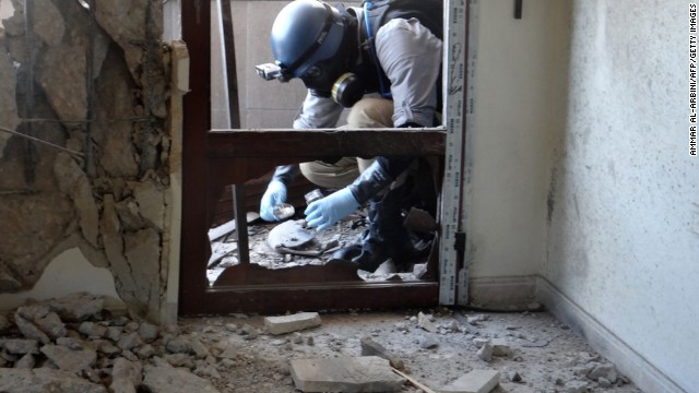 A U.N. arms expert collects samples during an inspection of a suspected chemical weapons strike site in the Ghouta area outside Damascus on Thursday, August 29. Syria has warned the United States against taking any military action after international outrage over the country's suspected use of chemical weapons. Tensions in Syria began to flare in March 2011 and have escalated into an ongoing civil war. Click through to view the most compelling images taken since the start of the conflict.