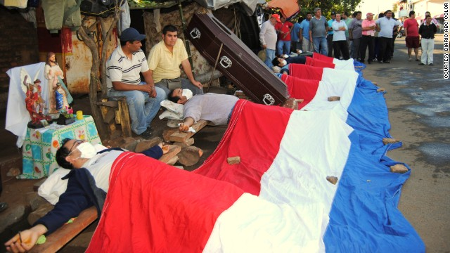 Eight bus drivers crucify themselves after getting fired in the city of Luque, Paraguay.