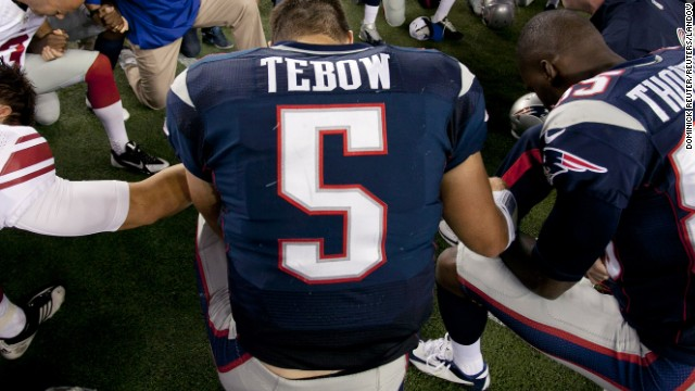 Backup quarterback Tim Tebow prays with his teammates and members of the New York Giants after their NFL preseason game in Foxborough, Massachusetts, on August 29. According to NFL.com, Tebow was released by the New England Patriots on Saturday, August 31. Critics have said the former Heisman Trophy winner doesn't throw well enough to be an NFL quarterback.
