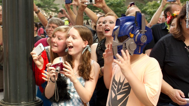 Onlookers react to the Dragon Con parade Saturday morning.