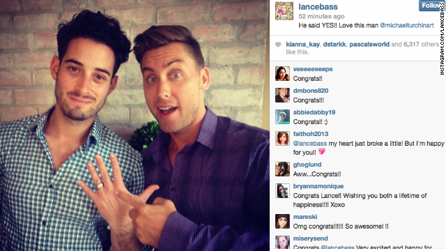 Lance Bass, right, popped the question to boyfriend Michael Turchin, and the couple announced their engagement on social media in September 2013 with a shot of Turchin flashing the ring.