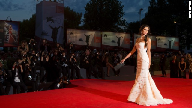 "Madalina Ghenea walks the red carpet before the showing of the film ""The Wind Rises"" on Sunday, September 1."