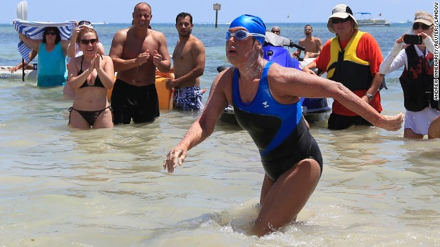 Nyad completes her swim from Cuba as fans cheer.
