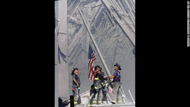 Firefighters George Johnson, Dan McWilliams and Billy Eisengrein raise a flag at ground zero in New York after the terror attacks on September 11, 2001. The scene was immortalized by photographer Thomas E. Franklin. The image has been widely reproduced in the decade since it was first published. View 25 of history's most iconic photographs.