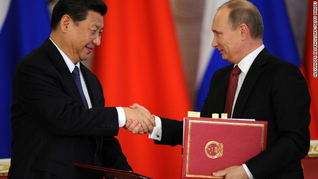 Russia's President Vladimir Putin (R) shakes hands with his Chinese counterpart Xi Jinping in Moscow, on March 22, 2013.