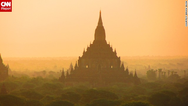 Buddhist temples peek through the <a href='http://ireport.cnn.com/docs/DOC-946879'>morning haze</a> in Bagan.