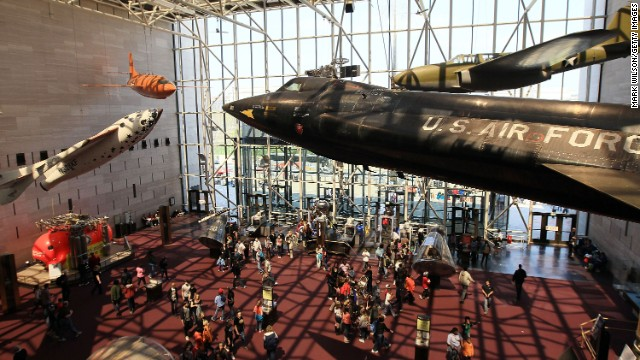 The National Air and Space Museum is the largest of the Smithsonian Institution's 19 museums. It houses approximately 60,000 objects connected with human flight, artwork and archival materials, including the 1903 Wright Flyer, Charles Lindbergh's Spirit of St. Louis and the Apollo 11 command module.