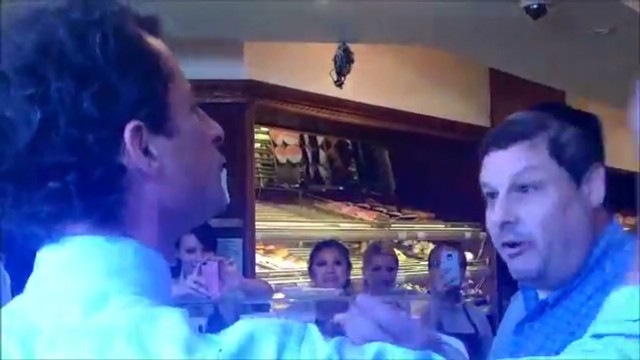 Weiner faces off with voter in Brooklyn bakery
