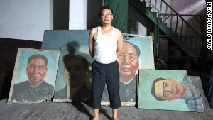 A superintendent of the former Workers\' Theatre proudly looks after old images of Hua Guofeng, Sun Yatsen, Mao Zedong and Zhou Enlai.
