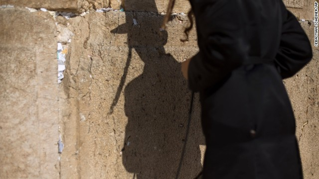 A young man prays at the Western Wall on September 4. Jewish people in Israel welcomed the new year late Wednesday despite turmoil brewing on the country's borders in Egypt and especially Syria.