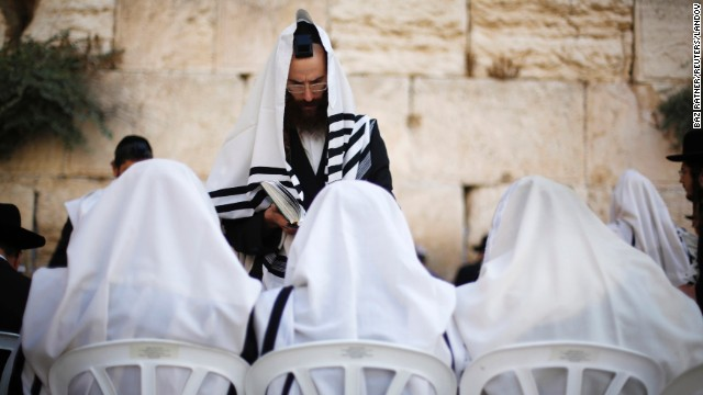 Covered in prayer shawls, Jewish worshipers gather at the Western Wall on September 4.