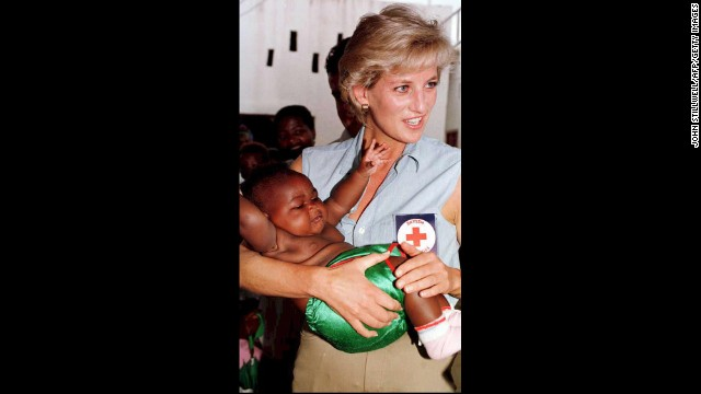 Princess Diana holds one of the many babies at the Kikolo health post during a visit to Luanda, Angola, on January 14, 1997.