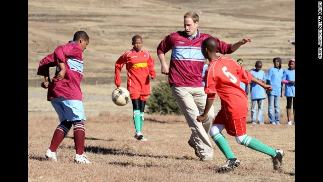 Prince William plays soccer during a visit to a child education center in Semonkong, Lesotho, on June 17, 2010. Whether it's been to strengthen political ties or to offer humanitarian aid, British royals have a long history of visiting Africa.