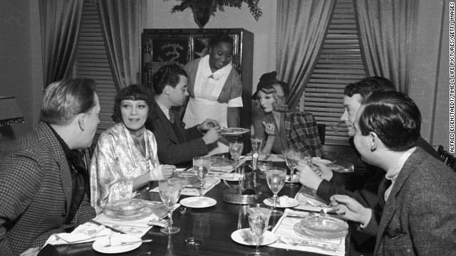 Sunday brunch at novelist Thyra Samter Winslow's Park Avenue home in 1937. Cynthia sits at center.