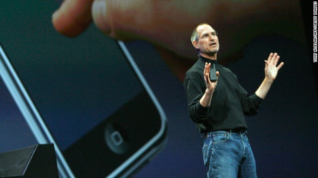 "Apple CEO Steve Jobs introduces the iPhone to the world January 9, 2007, at the Macworld conference in San Francisco. It went on sale five months later. It seems quaint now, but the original Getty Images photo caption that day described ""a new mobile phone that can also be used as a digital music player and a camera, a long-anticipated device dubbed an 'iPhone.' """