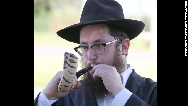 Rabbi Yossi Hecht blows the shofar during a ceremony in Ocala, Florida, on September 5. Hecht held the Tashlich (to cast) for people to cast their sins out over the water in order to start the new year with no sins.