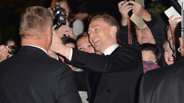 """Actor Tom Hiddleston greets fans at the """"Only Lovers Left Alive"""" premiere at the Ryerson Theatre on September 5."""