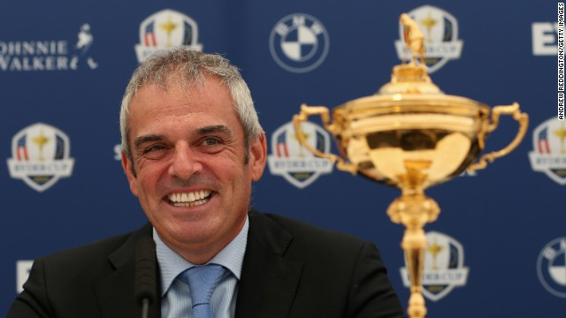 McGinley, the European captain for 2014, is all smiles as he parades the Ryder Cup ahead of next year's title defense in Scotland.