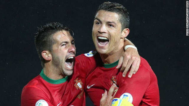 Portugal's Cristiano Ronaldo (right) celebrates scoring his second goal against Northern Ireland at Windsor Park in Belfast.