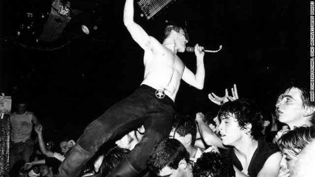 "From Northern California came the Dead Kennedys, whose name provoked the desired clucking from the offended classes. One wonders if they ever listened to the music, which included ""California Uber Alles"" and ""Holiday in Cambodia."" But even punks have capitalist troubles: Leader Jello Biafra was sued by his bandmates over royalties."