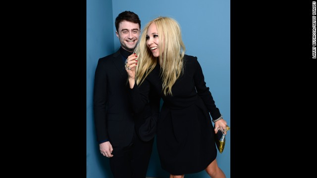 """Actors Daniel Radcliffe and Juno Temple of """"Horns"""" pose at the Guess Portrait Studio on September 6."""
