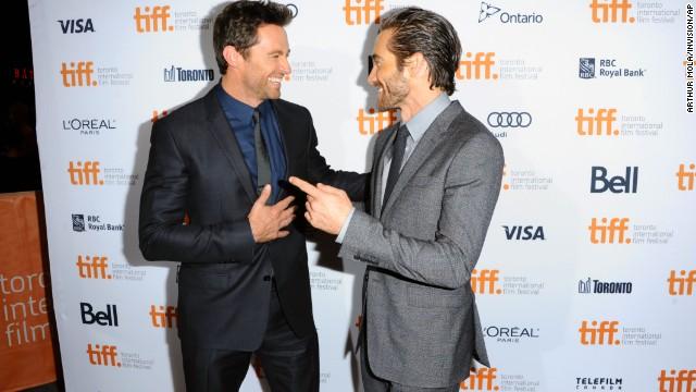 "Hugh Jackman, left, and Jake Gyllenhaal arrive at the premiere of ""Prisoners"" at the Elgin Theatre on September 6."