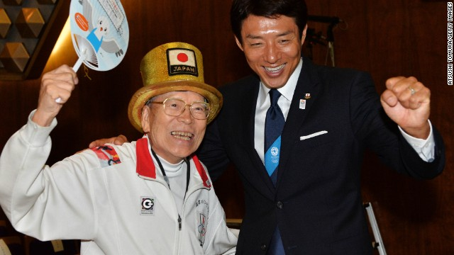"Octogenarian ""Olympic superfan"" Naotoshi Yamada (L) and former Japanese tennis player Shuzo Matsuoka (R) were among those to cheer the announcement in the early hours of Sunday morning in Tokyo."