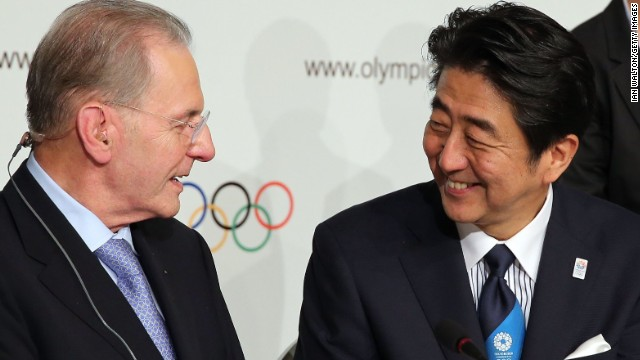 Abe is congratulated by IOC president Jacques Rogge (left) who is standing down after 12 years in the role. The 71-year-old's successor will be elected on Tuesday.