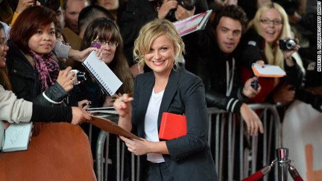 """Actress Amy Poehler signs autographs at the """"You Are Here"""" premiere at the film festival on Saturday, September 7."""