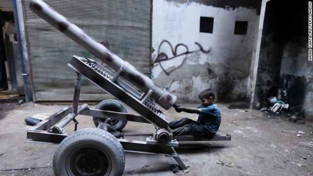 Issa fixes a mortar launcher in the Aleppo weapons factory on September 7.