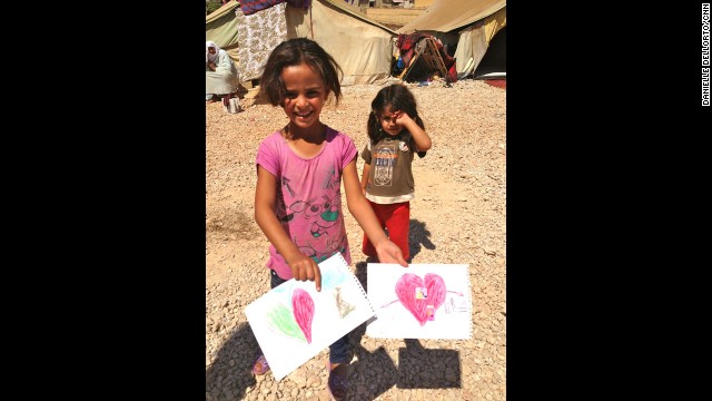 At a makeshift refugee area, just half a mile from the Syrian border, two young girls colored pictures and sang songs. They both left Syria without their parents.